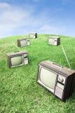 Campo di erba con le retro TV Immagine Stock Libera da Diritti
