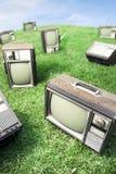 Campo di erba con le retro TV Fotografia Stock Libera da Diritti