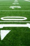 Campo di football americano del tappeto erboso di Astro Fotografie Stock Libere da Diritti