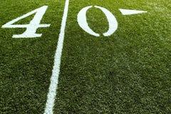Campo di football americano sul linea delle yard 40 Fotografie Stock Libere da Diritti