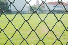 Campo dietro la rete metallica Immagine Stock Libera da Diritti