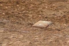 Campo do basebol ou de softball da placa home fotografia de stock