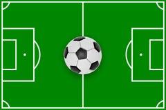 Campo e bola de futebol Foto de Stock