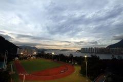 Campo e tramonto di sport Fotografie Stock