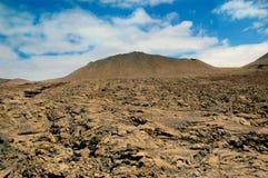 Campo e vulcão de lava Fotos de Stock Royalty Free