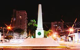 Obelisk of Campo Grande MS on Afonso Pena Avenue. Campo Grande, Brazil - April 14, 2018: White obelisk on downtown of the city at the Afonso Pena avenue in Royalty Free Stock Photos