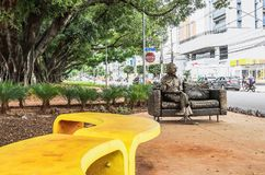 Sculpture in tribute to the poet Manoel de Barros on the sidewal. Campo Grande, Brazil - February 24, 2018: Sculpture in tribute to the poet Manoel de Barros on Royalty Free Stock Photo