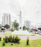 White obelisk on downtown of the city on the Afonso Pena avenue. Campo Grande, Brazil - February 24, 2018: White obelisk on downtown of the city on the Afonso Royalty Free Stock Image