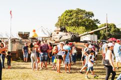 People visiting and taking photos of a war tank. Campo Grande, Brazil - September 09, 2018: People visiting and taking photos of a war tank at the military air royalty free stock image