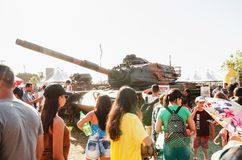 People visiting and taking photos of a war tank. Campo Grande, Brazil - September 09, 2018: People visiting and taking photos of a war tank at the military air stock photos