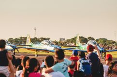 People watching the Esquadrilha da Fumaca airplanes. Campo Grande, Brazil - September 09, 2018: People watching the Esquadrilha da Fumaça airplanes FAB royalty free stock photography