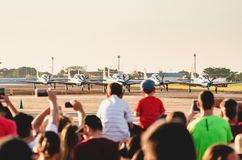 People watching the Esquadrilha da Fumaca airplanes stock photography