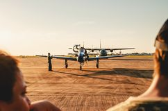 People watching the Esquadrilha da Fumaca airplanes. Campo Grande, Brazil - September 09, 2018: People watching the Esquadrilha da Fumaça airplanes FAB stock images