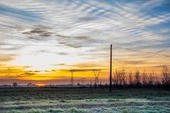 Campo no nascer do sol Fotos de Stock Royalty Free