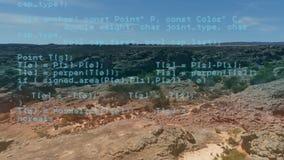 Campo rocoso y códigos digitales almacen de video