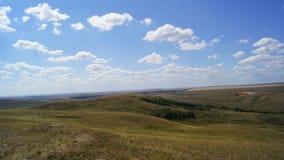 Campo sob o céu azul Imagem de Stock Royalty Free