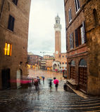 Campo Square with Mangia Tower in Siena Royalty Free Stock Image