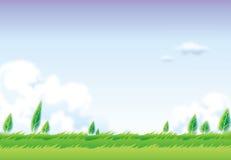 Campo verde y cielo azul Foto de archivo libre de regalías