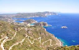 Campo y costa en la isla de Corfú, Grecia foto de archivo