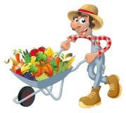 Camponês com wheelbarrow, vegetais e frutas.