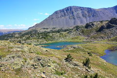 Camporells lake and Peric peak in Pyrenees. Capcir,Roussillon region of France Royalty Free Stock Photo