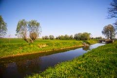 Campos da agricultura e um canal fotos de stock