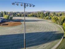 Campos de béisbol cubiertos por la helada Imagenes de archivo