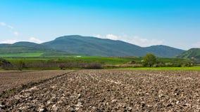 Campos de exploração agrícola arados imagens de stock royalty free
