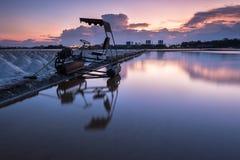 Campos de la sal en la puesta del sol Imagen de archivo libre de regalías