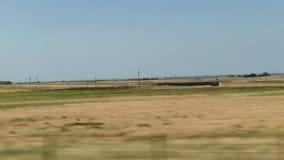 Campos vistos da estrada central de Califórnia do carro movente vídeos de arquivo