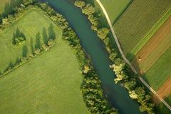 Campos y río Imágenes de archivo libres de regalías