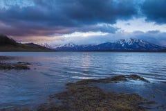 Campotosto lake at dark sunset in the winter season Stock Photos