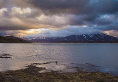 Campotosto lake at dark sunset in the winter season Stock Photography