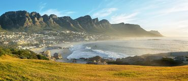 Camps Bay Beach in Cape Town, South Africa. With the Twelve Apostles in the background Royalty Free Stock Photos