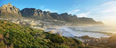 Camps Bay Beach in Cape Town, South Africa. With the Twelve Apostles in the background stock image