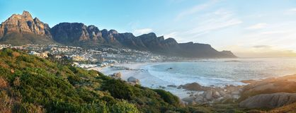 Camps Bay Beach in Cape Town, South Africa. With the Twelve Apostles in the background Royalty Free Stock Photography
