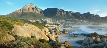 Camps Bay Beach in Cape Town, South Africa. With the Twelve Apostles in the background royalty free stock image