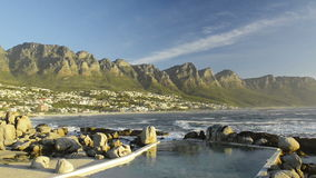 Camps Bay Cape Town South Africa. Beautiful Camps Bay at the base of Table Mountain in Cape Town, South Africa at sunset in high definition footage stock footage