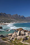 Camps Bay viewed from Maidens Cove in Cape Town Stock Photography