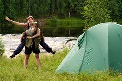 Campsite. Young couple tent camping in the wilderness Stock Photo