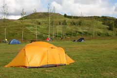 Campsite. Tents in Geysir - famous tourist area in Iceland. Summer camping royalty free stock images