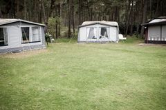 Campsite. Caravans with tent on campsite stock images