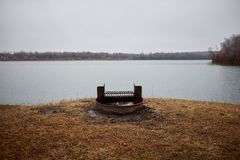 Campsite with barbecue overlooking a lake. Campsite with barbecue overlooking a tranquil lake at Miami County Fishing Lake, Kansas stock photo