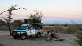 Campsite in Central Kalahari Game Reserve with Vehicle. Picture of person camping at Central Kalahari game reserve in Botswana. This is a campsite without fences Royalty Free Stock Photo