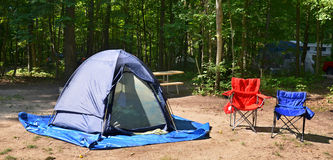 Campsite with chairs and tent Royalty Free Stock Photography