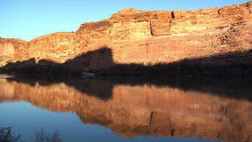 Campsite and colorado river red rock cliffs at sunset. Video of campsite and colorado river red rock cliffs at sunset stock footage