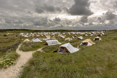 Campsite in the dunes. Under a clouded sky on the wadden island of Vlieland royalty free stock photos