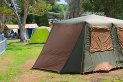 Campsite with tents in Australia. Campsite with eucalyptus trees and traveller& x27;s tents on grass in Australia. Australian campground during a holiday season royalty free stock photo