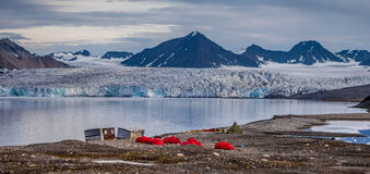 Campsite in front of a glacier. Svalbard stock photography