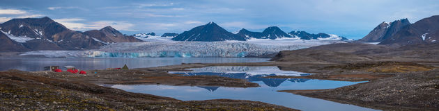 Campsite in front of a glacier. Svalbard stock images